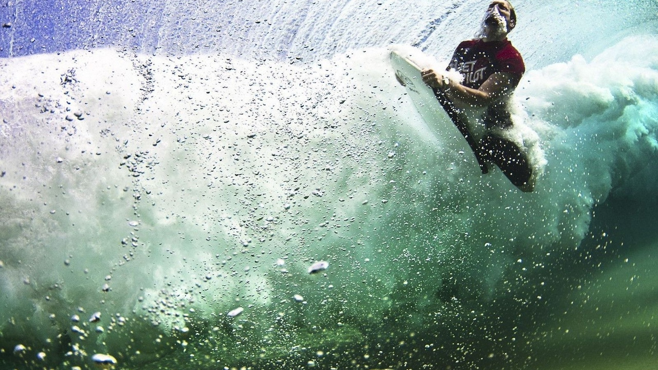 under water surfing board guy sea bubbles x