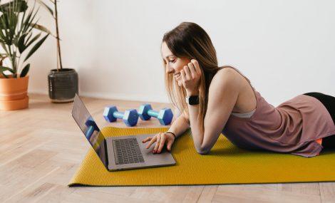Female freelancer on yoga mat